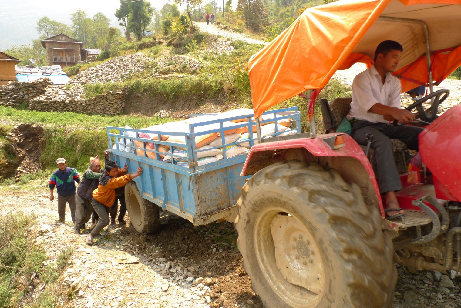 By tractor truck foot supplies reach rural nepal for Kitchen equipment in nepal