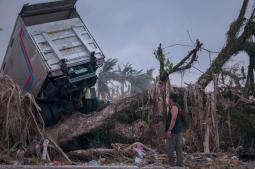 A man is dwarfed by the scale of the disaster created by Super Typhoon Haiyan. (Photo by John Chau / Used by permission)