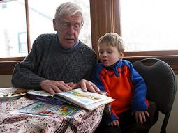 Fred Ritchie reads a peace book to great-grandson, Simon Clark.