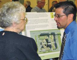Anne Driediger, a resident at Bethany Manor, speaks with a Saskatoon, Sask., city planner about the seniors complex expansion.