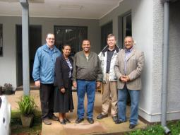 (From left) Doug Roth Amstutz, Yeshiareg Yohannes (MCC Ethiopia office administrator, secretary), Solomon Teferi (MCC Ethiopia Assistant Program Manager), Don Peters (MCC Canada Executive Director), Mekonnen Dessalegne (Program Manager).